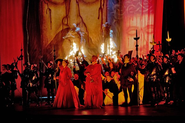 In this Feb. 19, 2013 photo provided by the Metropolitan Opera, the cast fill the stage during a dress rehearsal of Don Carlo at the Metropolitan Opera in New York. (AP Photo/Metropolitan Opera, Ken Howard)