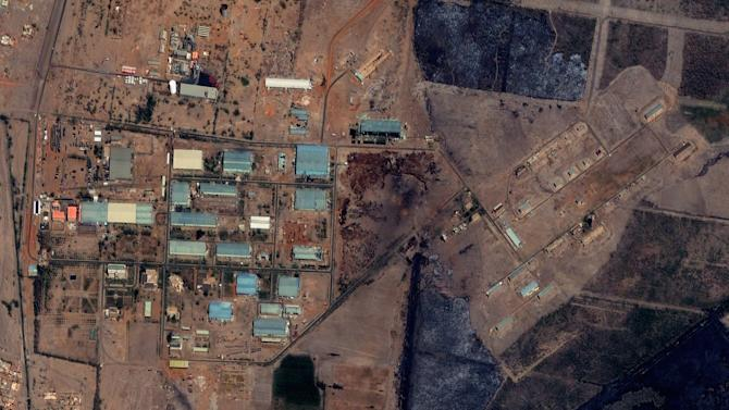 "The Yarmouk military complex in Khartoum, Sudan seen in a satellite image made on October 12 2012, prior to the alleged attack. A U.S. monitoring group says satellite images of the aftermath of an explosion at a Sudanese weapons factory suggest the site was hit by an airstrike. The Sudanese government has accused Israel of bombing its Yarmouk military complex in Khartoum, killing two people and leaving the factory in ruins.The images released by the Satellite Sentinel Project to The Associated Press on Saturday Oct 27 2012 showed several 52-foot wide craters. A spokesman for the project said military experts found the craters to be ""consistent with large impact craters created by air-delivered munitions."" Israeli officials have neither confirmed nor denied striking the site, instead accusing Sudan of playing a role in an Iranian-backed network of arms shipments to Hamas and Hezbollah.  (AP Photo/ DigitalGlobe via Satellite Sentinel Project)"