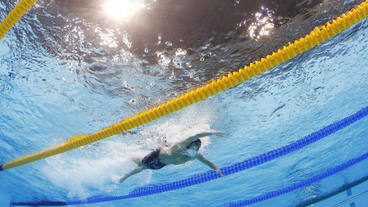 United States' Ryan Lochte swims on his way to win the men's 400-meter individual medley swimming final at the Aquatics Centre in the Olympic Park during the 2012 Summer Olympics in London, Saturday, July 28, 2012. (AP Photo/David J. Phillip)