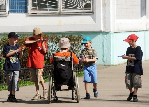 <p>Children play on in an orphanage in Moscow May 12, 2010. The Russian parliament will vote this week on a bill banning adoption of Russian children by Americans, in retaliation to the Magnitsky Act passed by the United States last week, lawmakers said.</p>