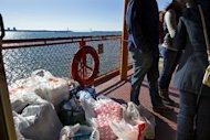Supplies are piled on the deck of a moving Staten Island ferry boat in New York, Sunday, Nov. 4, 2012. With the cancellation of the New York Marathon, hundreds of runners, wearing their marathon shirts and backpacks full of supplies, took the ferry to hard-hit Staten Island and ran to neighborhoods hard hit by Superstorm Sandy to help.(AP Photo/Craig Ruttle)