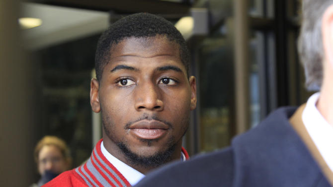 New England Patriots cornerback Alfonzo Dennard exits the Lancaster County courthouse in Lincoln, Neb., Thursday, April 11, 2013, behind his attorney Terry Dougherty, after being sentenced to two years probation, 100 hours of community service and 30 days in jail starting March 1, 2014. Dennard was found guilty of assaulting a police officer and resisting arrest in an incident in Lincoln, Neb. last year. (AP Photo/Nati Harnik)