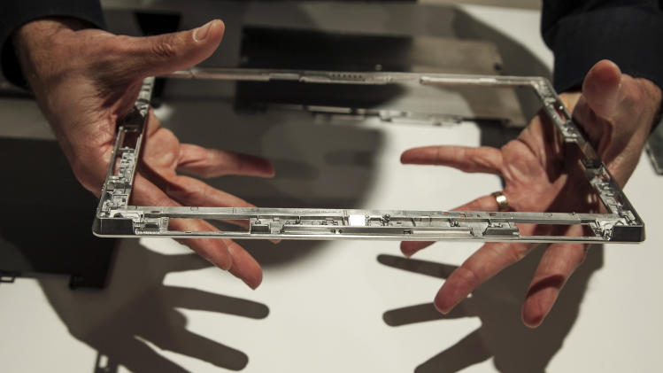 "The internal metal frame of the new Microsoft ""Surface,"" a tablet computer to compete with Apple's iPad, is shown at Hollywood's Milk Studios in Los Angeles, Monday, June 18, 2012. The 9.3 millimeter thick tablet comes with a kickstand to hold it upright and keyboard that is part of the device's cover. It weighs under 1.5 pounds. (AP Photo/Damian Dovarganes)"