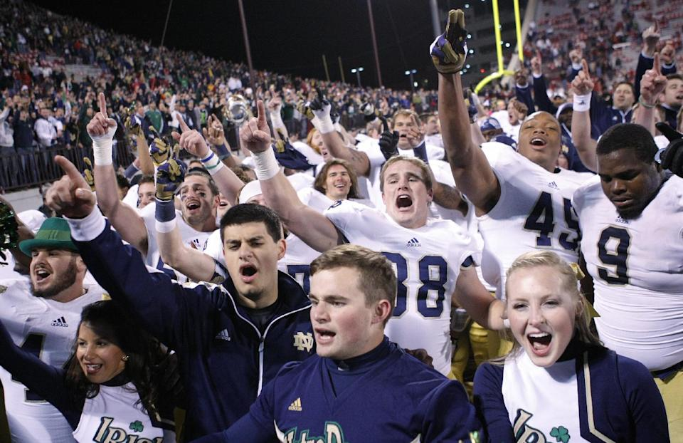 Notre Dame celebrates after defeating Oklahoma 30-13 in an NCAA college football game in Norman, Okla., Saturday, Oct. 27, 2012. (AP Photo/Alonzo Adams)