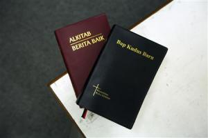 Picture illustration shows two copies of the Bible in Malay and the Iban dialect
