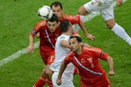 Russia midfielder Alan Dzagoev (left) scores against Poland during the Euro 2012 championships match at the National Stadium in Warsaw on June 12. A Polish football fan was so devastated when Russia scored that he threw his television set out his third-storey window, police said Wednesday