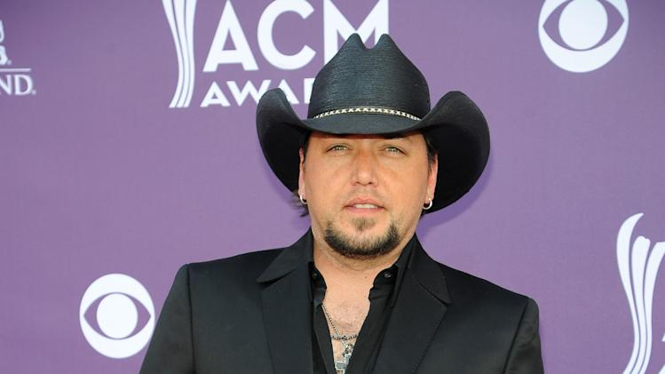 Singer Jason Aldean arrives at the 48th Annual Academy of Country Music Awards at the MGM Grand Garden Arena in Las Vegas on Sunday, April 7, 2013. (Photo by Al Powers/Invision/AP)