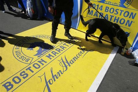 "Boston Police dog ""Titan"" and his handler Officer Joel Rodriguez patrol the finish line of the Boston Marathon in Boston"