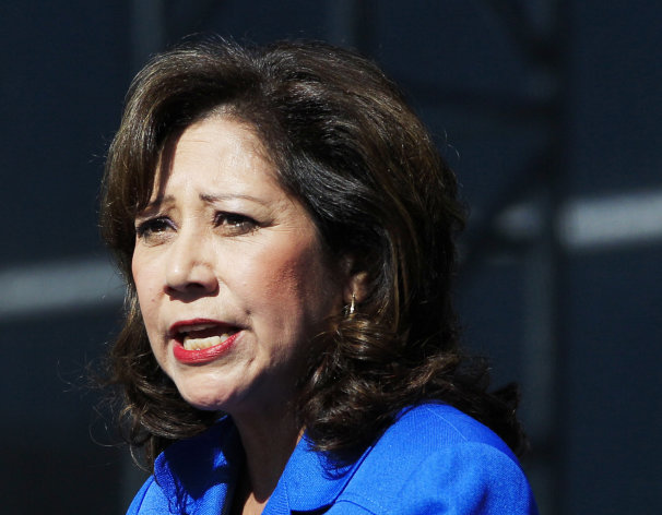 <p>               FILE - This Sept. 10, 2012 file photo shows Labor Secretary Hilda Solis addresses employees outside the Flat Rock Assembly in Flat Rock, Mich. Solis told colleagues she is resigning from Obama administration.  (AP Photo/Carlos Osorio, File)