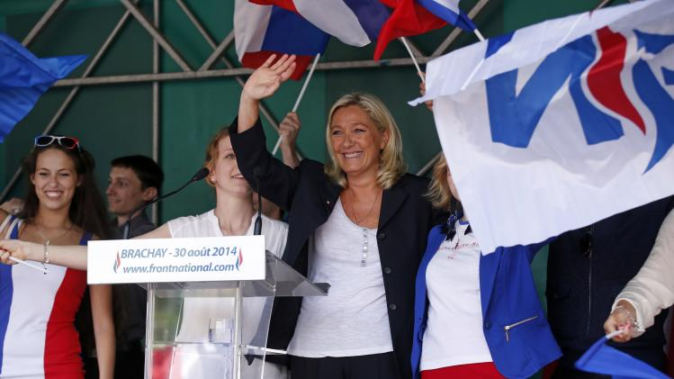Marine Le Pen, France's National Front political party leader, waves at the end of a rally in Brachay northern France