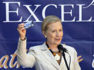 US Secretary of State Hillary Rodham Clinton, holds up a care card for patient medical information during her visit to the newly opened University Teaching Hospital Pediatric Centre of Excellence, in Lusaka, Zambia, Saturday, June 11, 2011. Clinton is on the first leg or a three-nation tour of Africa. (AP Photo/Susan Walsh, Pool)