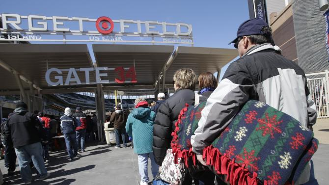 Basebal fans came equipped to Target Field with warm clothes and some with blankets as temperatures in the upper 20's welcomed the season opener between the Detroit Tigers and the Minnesota Twins before a baseball game Monday, April 1, 2013 in Minneapolis. (AP Photo/Jim Mone)