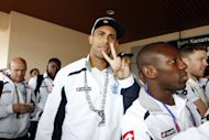 Queens Park Rangers defender Anton Ferdinand gestures as he leaves the airport with his teammates upon their arrival in Kota Kinabalu, the capital of Malaysia's Sabah state on Borneo island on July 14. Ferdinand declined to comment on John Terry being cleared of racially abusing him, as the QPR defender arrived in Malaysia for a pre-season tour
