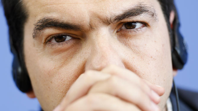 Alexis Tsipras, the leader of Greece's anti-austerity Syriza coalition attends a news conference with German Left Party leaders in Berlin, Germany, May 22, 2012. (AP Photo/Markus Schreiber)