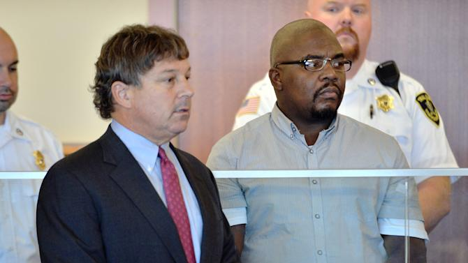 Ernest Wallace of Bristol, Conn., right, an associate of former New England Patriots player Aaron Hernandez, stands beside his attorney David Meier during his arraignment in Superior Court Thursday, Sept. 19, 2013, in Fall River, Mass. Wallace pleaded not guilty to an accessory to murder charge in connection with the death of Odin Lloyd, 27, whose body was found in North Attleborough, Mass., about a mile from Hernandez's home. (AP Photo/Josh Reynolds, Pool)