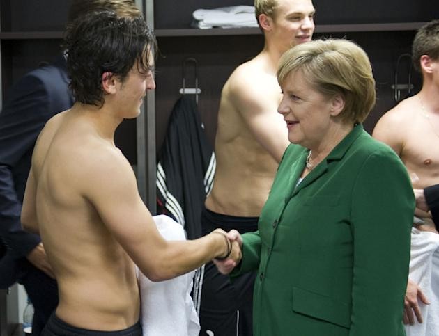 FILES - Picture Released By The German Government Press Service Shows German Chancellor Angela Merkel Congratulating  AFP/Getty Images