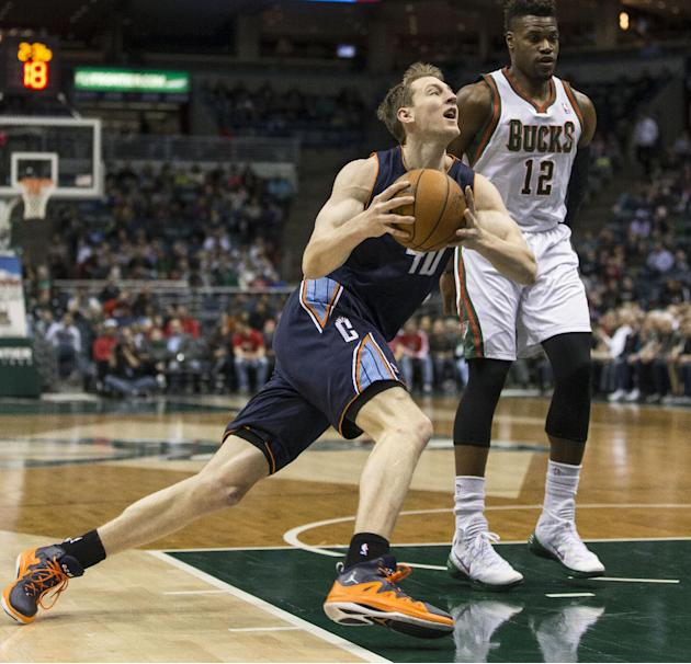 Milwaukee Bucks' Jeff Adrien, right, is called for a foul while guarding Charlotte Bobcats' Cody Zeller during the first half of an NBA basketball game on Sunday, March 16, 2014, in Milwaukee