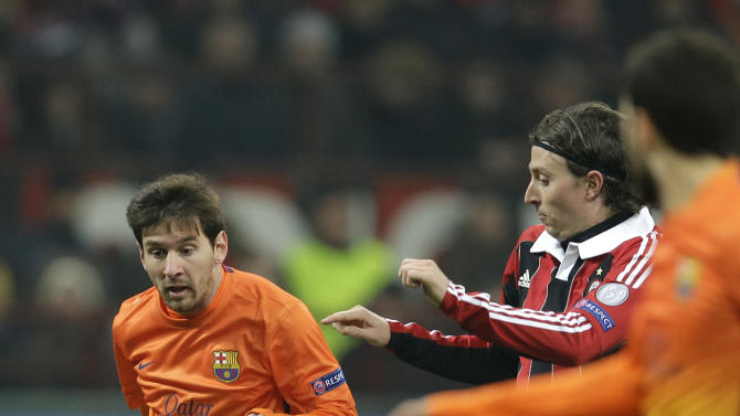 Barcelona forward Lionel Messi, of Argentina, left, is challenged by AC Milan midfielder Riccardo Montolivo  during their Champions League round of 16, first leg soccer match, at the San Siro stadium in Milan, Italy, Wednesday, Feb. 20, 2013. (AP Photo/Luca Bruno)