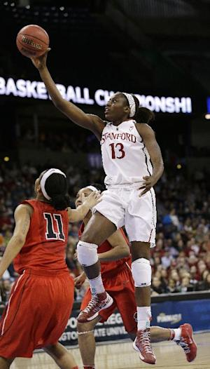 FILE - In this Nov. 5, 2013 file photo, Stanford's Chiney Ogwumike drives past Georgia defenders in the first half of a regional semifinal in the NCAA women's college basketball tournament, in Spokane, Wash. Ogwumike was selected to The Associated Press' preseason women's All-America team, released Tuesday, Nov. 5, 2013. (AP Photo/Elaine Thompson, File)