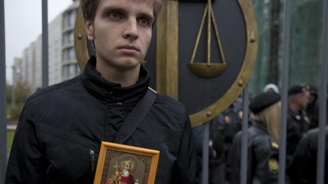 An Orthodox believer protests outside a court in Moscow, Wednesday. Oct. 10, 2012. Three members of the punk band Pussy Riot are set to make their case before a Russian appeals court that they should not be imprisoned for their irreverent protest against President Vladimir Putin. (AP Photo/Alexander Zemlianichenko)