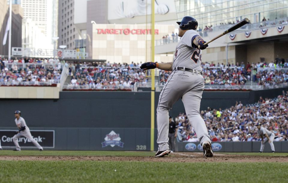 Detroit Tigers' Miguel Cabrera watches his three-run home run off Minnesota Twins' Casey Fien in the eighth inning of a baseball game Saturday, Sept. 29, 2012, in Minneapolis. The homer tied him with Texas' Josh Hamilton. (AP Photo/Jim Mone)
