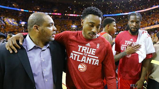 Atlanta Hawks' Jeff Teague, Kent Bazemore and DeMarre Carroll, from second from left, walk off the court after the team's 118-88 loss to the Cleveland Cavaliers in Game 4 of the Eastern Conference finals of the NBA basketball playoffs, Tuesday, May 26, 2015, in Atlanta. (Curtis Compton/Atlanta Journal-Constitution via AP)