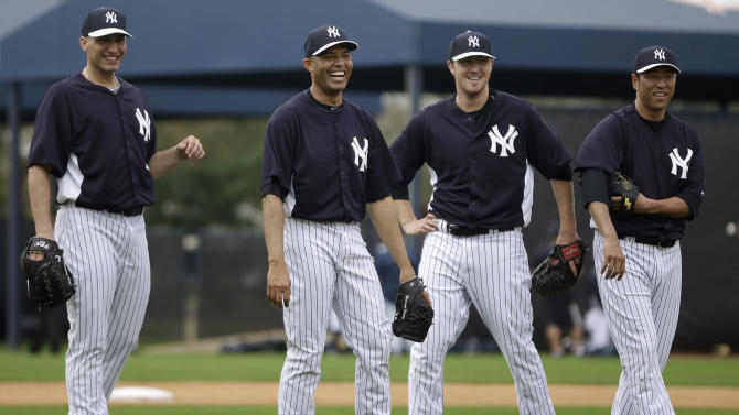 New York Yankees' Andy Pettitte, from left, Mariano Rivera, Phil Hughes and Hiroki Kuroda, of Japan, laugh during a workout at baseball spring training, Wednesday, Feb. 13, 2013, in Tampa, Fla. (AP Photo/Matt Slocum)