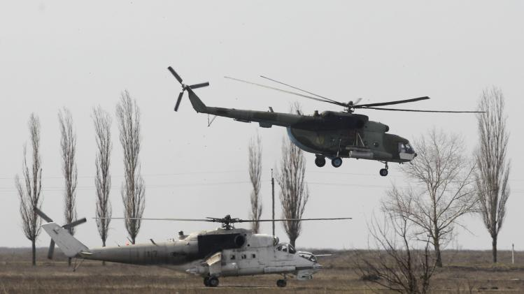 Helicopters are seen during a military drill conducted by Ukrainian servicemen near the city of Mykolaiv, also known as Nikolayev, in southern Ukraine