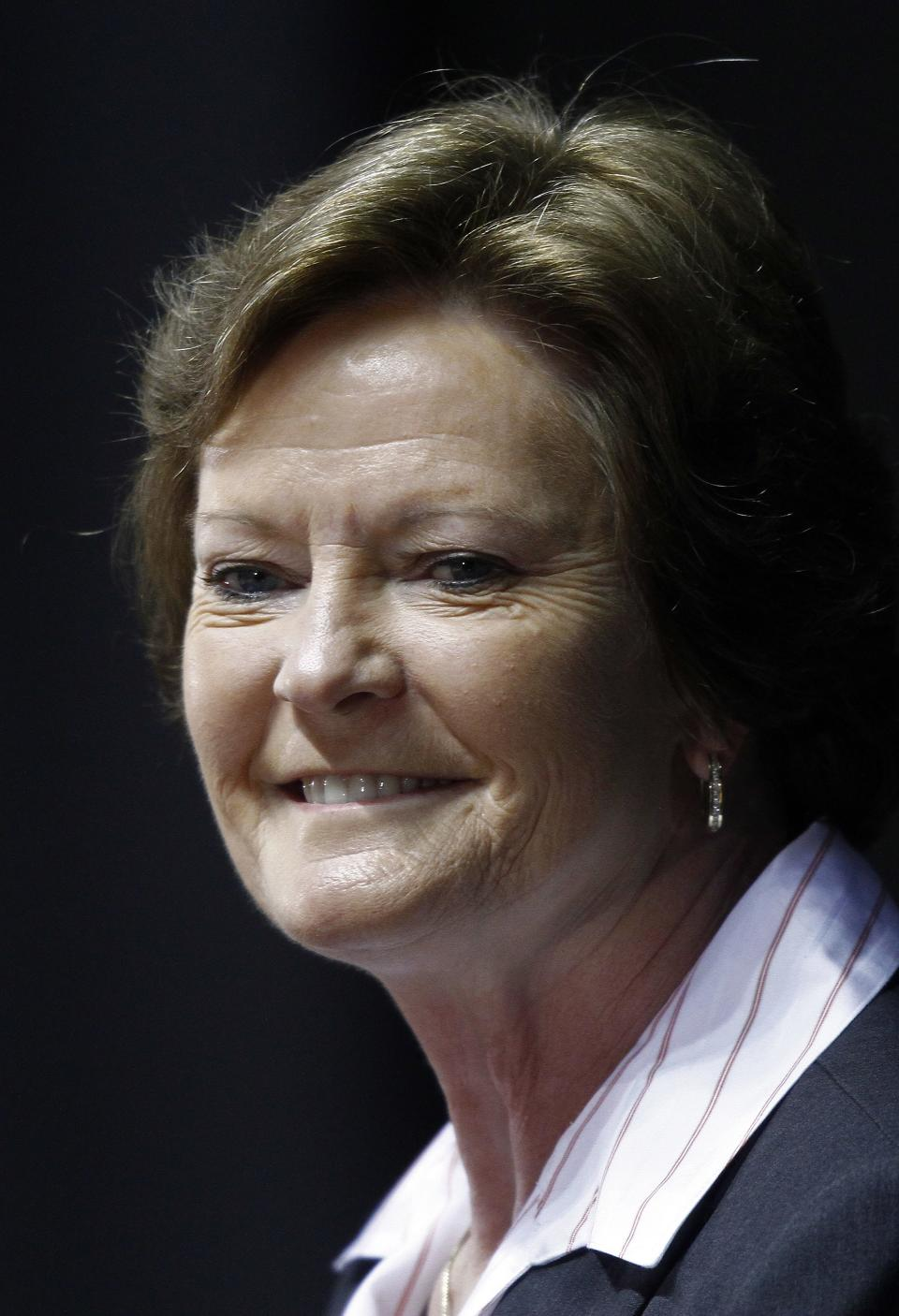 Former Tennessee women's college basketball coach Pat Summitt smiles as she appears at a news conference Thursday, April 19, 2012, in Knoxville, Tenn. Summitt stepped aside after 38 seasons, the last an emotionally draining farewell tour for the woman who won more games than anyone else in NCAA college basketball history. (AP Photo/Wade Payne)