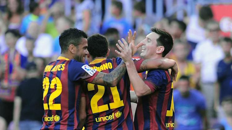 FC Barcelona's Lionel Messi, from Argentina, right, reacts after scoring with his teammates against Levante during a Spanish La Liga soccer match at the Camp Nou stadium in Barcelona, Spain, Sunday, Aug. 18, 2013. (AP Photo/Manu Fernandez)