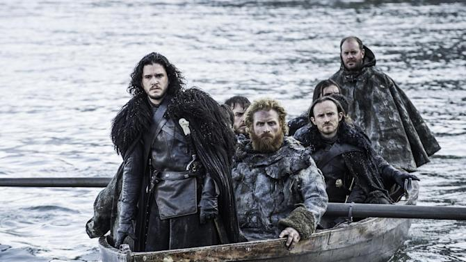 "This image released by HBO shows Kit Harington as Jon Snow, left, in a scene from ""Game of Thrones."" HBO programming chief Michael Lombardo said Thursday, July 30, 2015, that the drama series' producers are leaning toward three more seasons after the just-concluded season five. Lombardo told a TV critics' meeting in Beverly Hills, Calif., that he hopes that they'll change their minds, but that appeared to be the intent. (Helen Sloan/HBO via AP)"