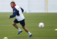 Britain's men's football player Craig Bellamy runs during a training session at the London 2012 Olympic Games in Cardiff July 31, 2012. REUTERS/Francois Lenoir
