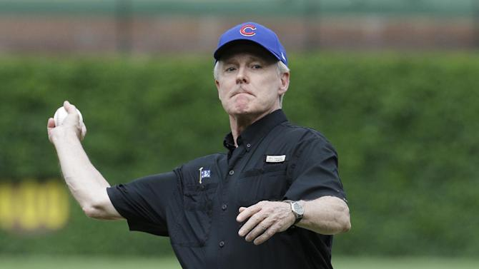 Secretary of the Navy Ray Mabus throws out the ceremonial first pitch before an interleague baseball game between the Kansas City Royals and the Chicago Cubs Friday, May 29, 2015, in Chicago. (AP Photo/Nam Y. Huh)