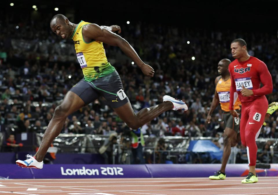 Jamaica's Usain Bolt crosses the finish line to win gold in the men's 100-meter final during the athletics in the Olympic Stadium at the 2012 Summer Olympics, London, Sunday, Aug. 5, 2012. (AP Photo/David J. Phillip )