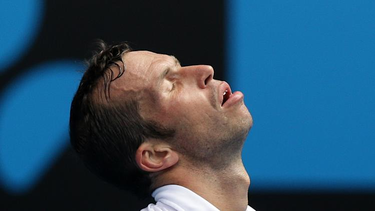 Radek Stepanek of the Czech Republic reacts during his third round match against Serbia's Novak Djokovic at the Australian Open tennis championship in Melbourne, Australia, Friday, Jan. 18, 2013.(AP Photo/Dita Alangkara)