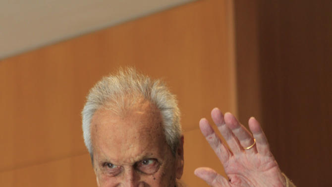 In this photo taken on March 22, 2012 Italian fashion designer Ottavio Missoni waves as he attends a journalism prize event in Milan, Italy. Italian fashion company Missoni says its co-founder, Ottavio Missoni, has died in his home earlier on Thursday, May 9, 2013 in northern Italy. Missoni, who was 92, founded the iconic fashion brand of zigzagged-patterned knitwear along with his wife, Rosita, in 1953. The Missonis are a family fashion dynasty, with the couple's children and their offspring involved in expanding the brand. (AP Photo/Luca Bruno)