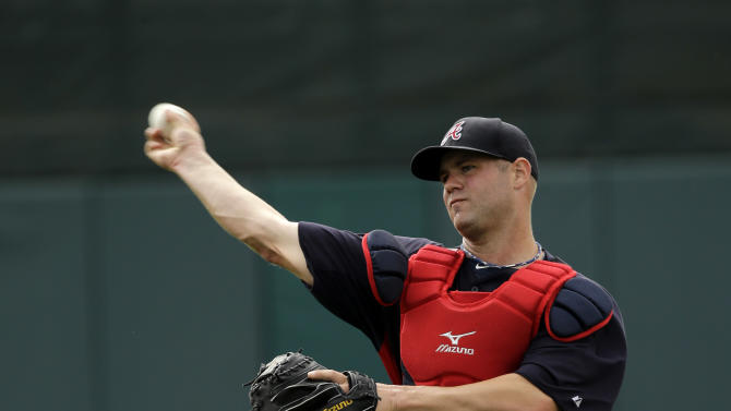 Atlanta Braves catcher Evan Gattis throws during a spring training baseball workout, Wednesday, Feb. 20, 2013, in Kissimmee, Fla. (AP Photo/David J. Phillip)
