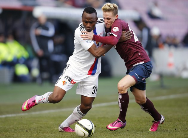 FC Basel's Daogari fights for the ball with FC Servette's Ruefli during their Swiss Super League soccer match in Geneva