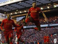 "Liverpool's Steven Gerrard (R) celebrates scoring against Tottenham Hotspur during their English Premier League soccer match at Anfield in Liverpool, northern England, March 10, 2013. REUTERS/Phil Noble (BRITAIN - Tags: SPORT SOCCER) FOR EDITORIAL USE ONLY. NOT FOR SALE FOR MARKETING OR ADVERTISING CAMPAIGNS. NO USE WITH UNAUTHORIZED AUDIO, VIDEO, DATA, FIXTURE LISTS, CLUB/LEAGUE LOGOS OR ""LIVE"" SERVICES. ONLINE IN-MATCH USE LIMITED TO 45 IMAGES, NO VIDEO EMULATION. NO USE IN BETTING, GAMES OR SINGLE CLUB/LEAGUE/PLAYER PUBLICATIONS"