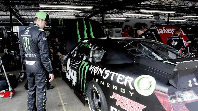 NASCAR driver Kurt Busch looks at his car in the garage area at Darlington Raceway during practice for the Nationwide Series auto race, Friday, May 11, 2012 in Darlington, S.C.  (AP Photo/Mary Ann Chastain)