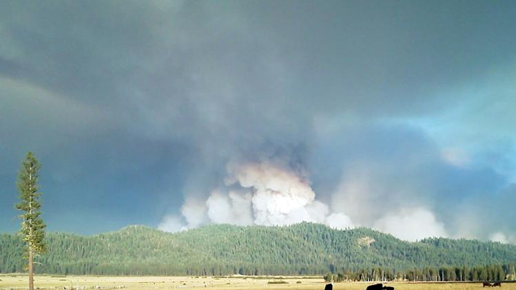 This image provided by Inci Web shows a plume of smoke Saturday Aug. 18, 2012 at the Chips Fire inside the Plumas National Forest in northern california. This fire has burned through 67 square miles and is 20 percent contained.(AP Photo/ InciWeb)