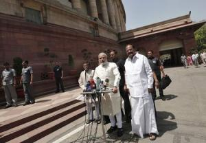 India's PM Modi speaks with the media as he arrives to attend his first Parliament session in New Delhi