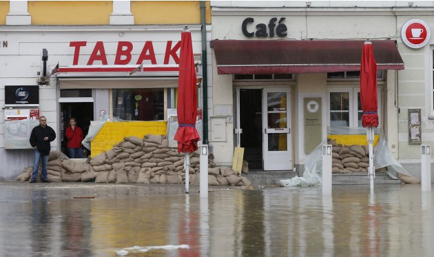 Residents look at a flooded street in the Austrian town of Melk