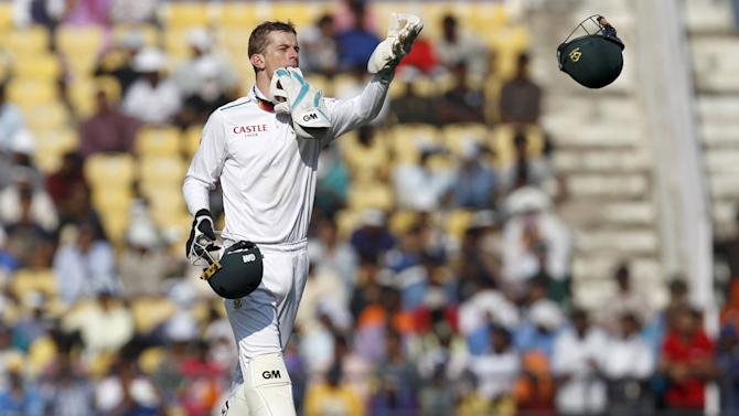 South Africa's wicketkeeper Dane Vilas throws a helmet during the first day of their third test cricket match against India in Nagpur