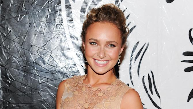 """FILE - In this May 15, 2013 file photo, actress Hayden Panettiere attends the Versus Versace and Capsule Collection fashion show at the 69th Regiment Armory, in New York. Panettiere is confirming her engagement to Olympic boxer Wladimir Klitschko. Appearing on """"Live with Kelly and Michael,"""" Wednesday, Oct. 9, 2013, the 24-year-old actress was flashing a large diamond ring that prompted host Kelly Ripa to inquire what it might signify. (Photo by Evan Agostini/Invision/AP, File)"""