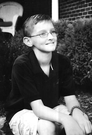 This photo provided by Brittney Galloway shows Lane Goodwin.  Lane Goodwin, a small-town boy who won a huge Facebook following for his thumbs-up attitude about his cancer, has lost his battle with the disease. The 13-year-old Kentuckian died Wednesday night, Oct. 17, 2012 eliciting an outpouring from his heartbroken followers. (AP Photo/Brittney Galloway)