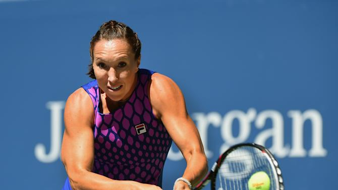 Jelena Jankovic of Serbia plays against Johanna Larsson of Sweden during their 2014 US Open women's singles match on August 29, 2014 in New York