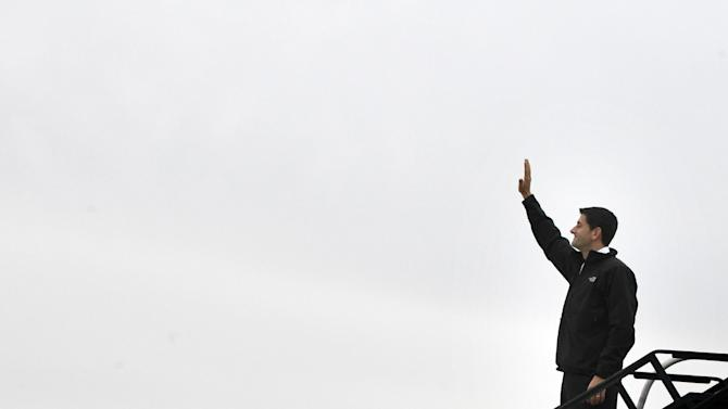 Republican vice presidential candidate, Rep. Paul Ryan, R-Wis. waves upon his arrival at Richmond International Airport, Tuesday, Nov. 6, 2012, in Richmond, Va.  (AP Photo/Mary Altaffer)