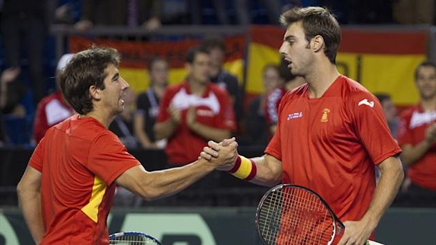 Spain&#39;s Marcel Granollers (R) and Marc Lopez celebrate their teams match win against Canada&#39;s Daniel Nestor and Vasek Pospisil during their doubles match on the second round of the Davis Cup
