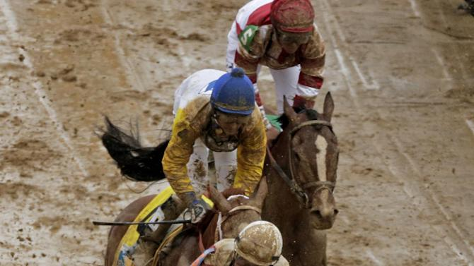 Joel Rosario rides Orb reacts after winning the 139th Kentucky Derby at Churchill Downs Saturday, May 4, 2013, in Louisville, Ky. (AP Photo/Charlie Riedel)